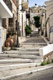 Street with stony steps at old town of Sitia town on Crete island, Greece Royalty Free Stock Image