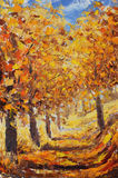 Street strewn with yellow leaves. Trees in autumn with Royalty Free Stock Photos