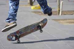 Street stunts with the Skateboard royalty free stock photo