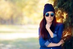 Street Style Fashion Girl in Denim Shirt Wearing Blue Sunglasses Stock Image