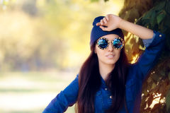 Street Style Fashion Girl in Denim Shirt Wearing Blue Sunglasses Royalty Free Stock Images