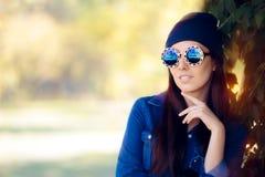Street Style Fashion Girl in Denim Shirt Wearing Blue Sunglasses Stock Photography
