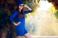 Street Style Fashion Girl Wearing a Blue Denim Romper Stock Photography