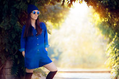 Street Style Fashion Girl Wearing a Blue Denim Romper Royalty Free Stock Photo