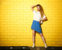 Street Style Hipster Fashion Girl at Yellow Wall Stock Images