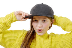 Street style hipster girl with hat and yellow pullover on white. A street style hipster girl with hat and yellow pullover on white background Royalty Free Stock Images