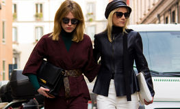Street Style: Milan Fashion Week Autumn/Winter 2015-16. February 2015: Annabel Rosendahl and Celine Aagaard spotted on the streets of Milan during Fashion Week Stock Images