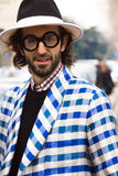Street Style during Milan Fashion Week for Fall/Winter 2015-16. January 2015: Manos Samartzis spotted on the streets of Milan during Fashion Week for Fall/Winter stock photos