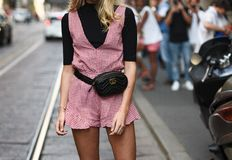 Street style outfits in detail during Milan Fashion Week - MFWSS19. September 21, 2018: Milan, Italy - Street style outfits in detail during Milan Fashion Week royalty free stock image