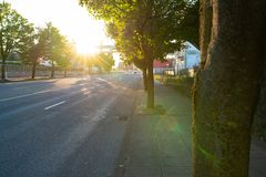Street sunset view with lens flare effect royalty free stock photography