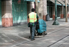 Street Sweeper. A man operating a street sweeper Stock Photo