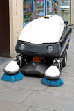 Street sweeper. Cleaning vehicle with revolving brushes Royalty Free Stock Image