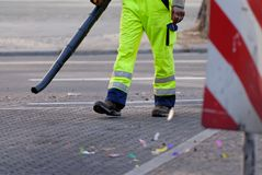 Street sweeper. A man cleaning a street in berlin royalty free stock photos