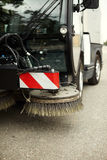 Street sweeper. Part of street sweeper, selective focus on nearest part Stock Photos