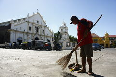 Street Sweeper. A photo of a street sweeper cleaning the church grounds in Vigan, Ilocos Sur, Philippines Stock Photography