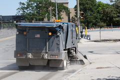Street Sweeper. A Street Sweeper cleans up the street Royalty Free Stock Photography
