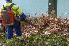 Street sweeper. Collects leaves from the fan motor Royalty Free Stock Photography