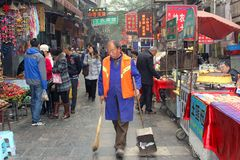 Street sweeper at work at the Beiyuanmen Muslim Market in Xian, China royalty free stock photo