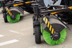 Street Sweeper Brooms. Trucks with street sweeper brooms in a line Stock Photo