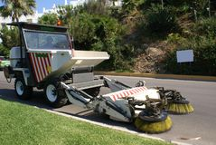 Street sweeper. A street sweeper or street cleaner may refer to either a person's occupation, or a machine that cleans streets Stock Photography