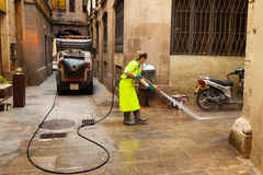 Street sweeper cleaning with water old district of  city. BARCELONA, SPAIN - JUNE 1: Wet cleaning of ancient streets in June 1, 2013 in Barcelona, Spain Stock Photo
