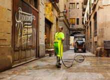 Street sweeper cleaning with water old district of european city. BARCELONA, SPAIN - JUNE 1: Wet cleaning of ancient streets in June 1, 2013 in Barcelona, Spain Royalty Free Stock Photos