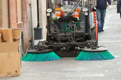Street sweeper machine cleaning the streets. A street sweeper machine cleaning the streets Stock Photos