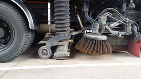 Street sweeper machine cleaning the streets . Royalty Free Stock Photos