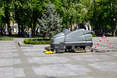 Street sweeper machine cleaning walkways in the park. Kremenchug, Ukraine - May 5, 2017: Street sweeper machine cleaning walkways in the park Royalty Free Stock Photos