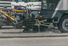 Street sweeper machine riding on asphalt royalty free stock images