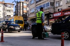 Street Sweeper Man In Cinarcik Town - Turkey. A street sweeper man in the streets of a small summer town named Cinarcik which is located in Marmara region of the Stock Photo