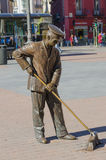 Street sweeper monument. Bronze Street sweeper monument in a street of Madrid Stock Photography