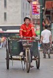 Street sweeper on an an old tricycle in Beijing, China. BEIJING-JUNE 9, 2015. Street sweeper on an old tricycle. China has a gigantic army of orange dressed Stock Photo