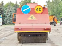 Street sweeper with signs. Road-building works,Street sweeper with signs Stock Photography