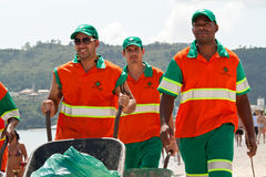 Street-sweeper team. Florianopolis, SC, Brazil - Feb 5, 2012: Street-sweeper team with the push carts taking care to keep the beach cleaned for its visitors. The Stock Photo