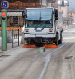 Street Sweeper Vehicle. Chamonix, France. Street Cleaner or Street Sweeper vehicle cleaning a street. Picture can be used for truthful articles in media, and for Stock Photography