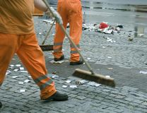Street sweepers. Two street sweepers remove litters after a festival Stock Photography