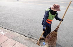 Street sweepers clean on a road stock images