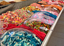 Street sweet stall shop. Street market stall selling tasty sweets stock photo