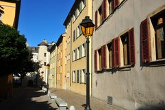 Street in Swiss Old Town. State finance buildings in the old town of Sion, Switzerland.  The area is pedestrian only with benches and street lamps in the middle Royalty Free Stock Photo