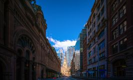 Street in sydney city with church background stock photos