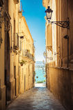 Street of Syracuse leading to the sea Stock Image