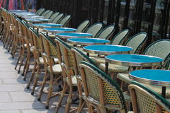 Street Tables. Row of Green Tables at the street cafe, Paris, France stock photo