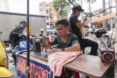 Street tailor in Ho Chi Minh city Royalty Free Stock Image