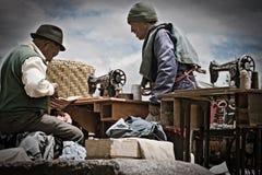 Street tailor at Saquisili market, Ecuador stock photography