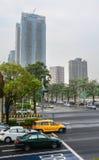 Street in Taipei city, Taiwan. Vehicles run on the street with many tall buildings in Taipei city, Taiwan Royalty Free Stock Photos