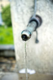 Street tap with running water Royalty Free Stock Photo
