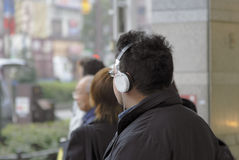 Street technology. Image of a man with headphones in a big city street Stock Images