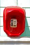 Street telephone. On the building wall Stock Photos