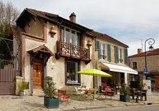 Street Terrace in Barbizon. Barbizon,France- April 4th, 2011:Image of a traditional house and a street terrace in Barbizon, located in center of France near the Stock Image